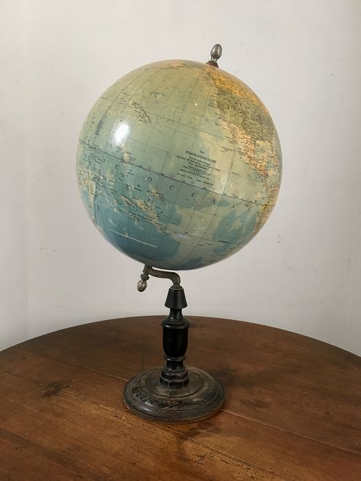 Stylish beautiful old globe on a black wooden base with a decorated metal frame. (1) - wood / iron / paper