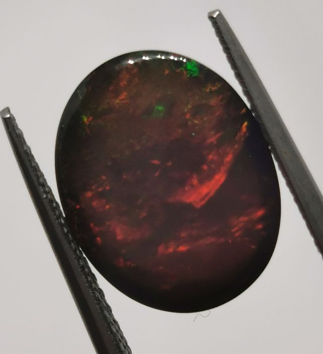 Black, With play of color Opal - 3.19 ct