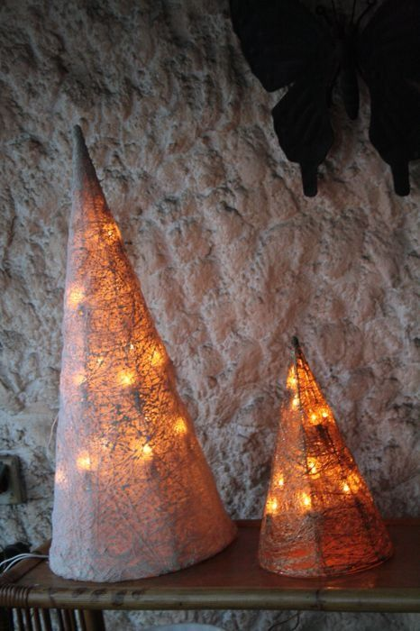 large illuminated pyramids - embroidery lace fabric and gold cane