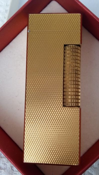 DUNHILL vintage gold plated lighter - made in Switzerland - US. RE 24163 PATENTED