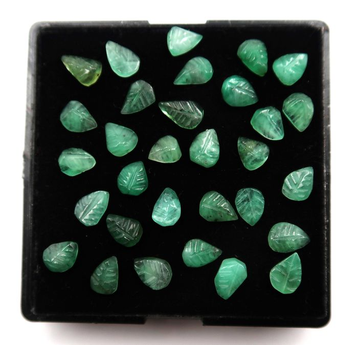 31 pcs  Esmeralda - 10.60 ct