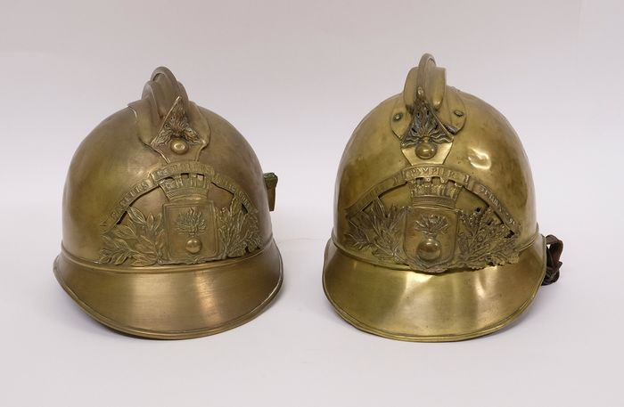 Two antique French fire helmets - Yellow copper