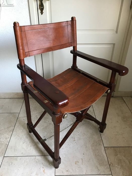 Chair, Classic brown leather folding with brass detailling