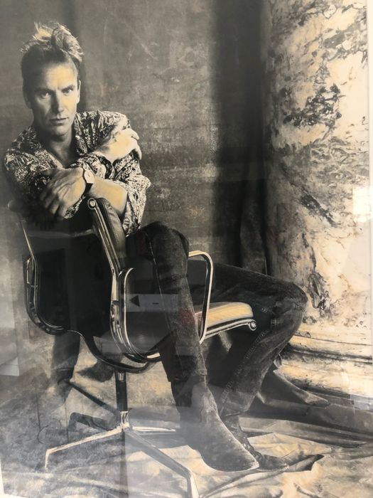 Photograph - Leadsinger The Police, Sting, sitting on an Eames EA207 / EA208 Soft Pad chair