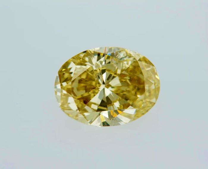 1 pcs Diamant - 1.00 ct - Oval - fancy vivid orangy yellow - SI1