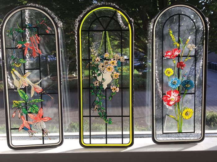 Three stained glass and lead window hangers of various floral designs - Glass (stained glass)