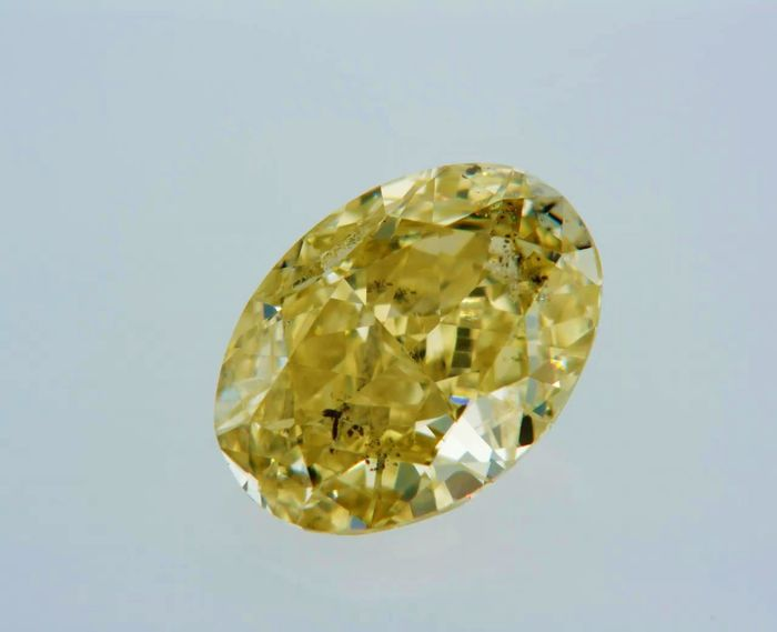 1 pcs Diamant - 1.03 ct - Oval - fancy intens yellow - SI2
