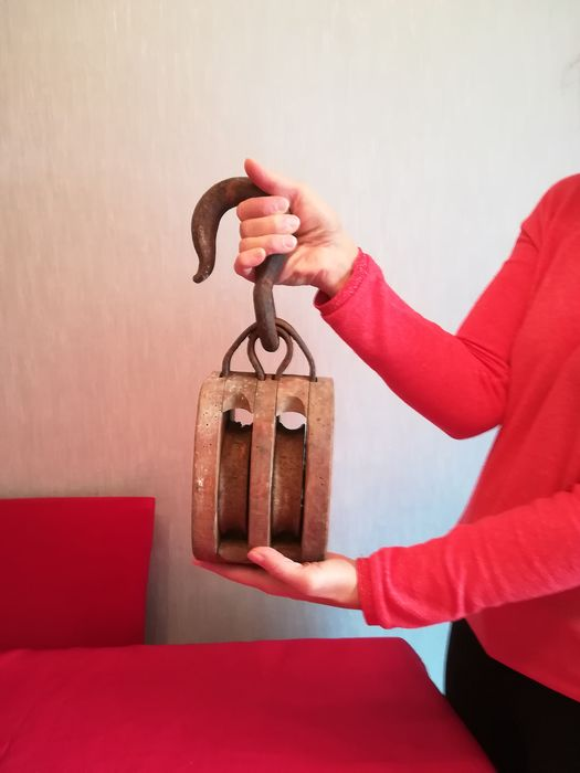 Old marine pulley made of forged steel and - Wood