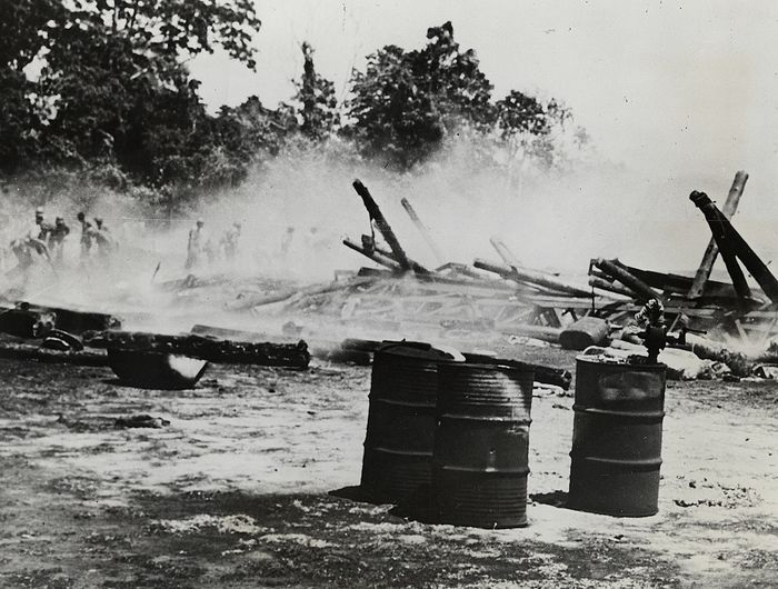 Unknown/U.S. Marine Corps/International News Photo - Marines Comb Smoldering Ruins of a Hangar on Guadalcanal, 1942