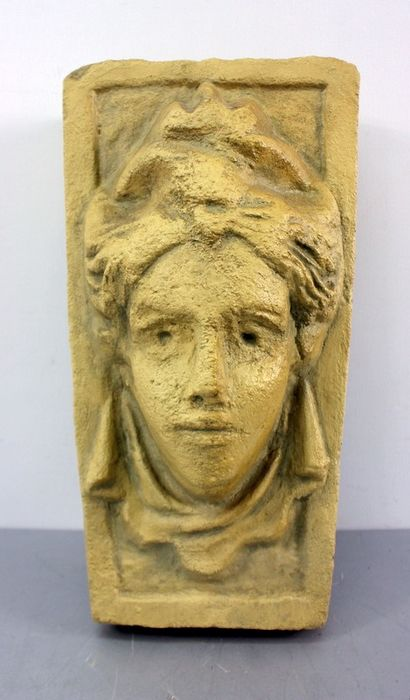 A wall console with a portrait of a woman, - composition stone