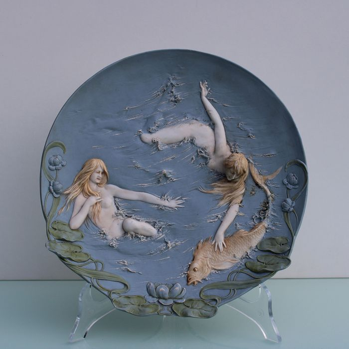 Art Nouveau wall plaque ladies with a fish