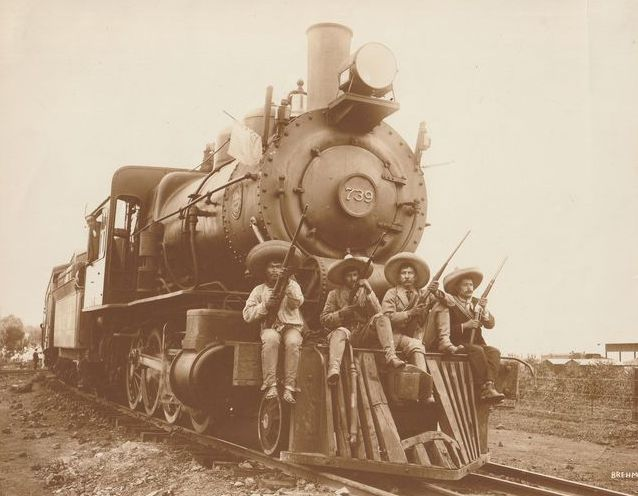 Hugo Brehme (1882-1955)  - Mexican revolution: Revolutionaries sitting on front of a steam train, 1970's