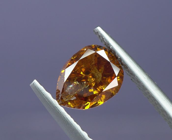 1 pcs Diamond - 0.74 ct - Pear  - fancy vivid yellow orange - I1- No Reserve