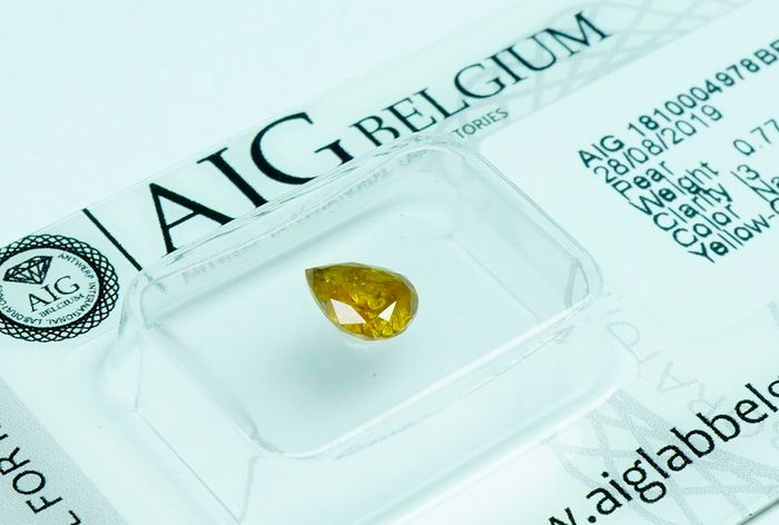 1 pcs Diamond - 0.77 ct - Pear  - fancy yellow orange - I3- No Reserve