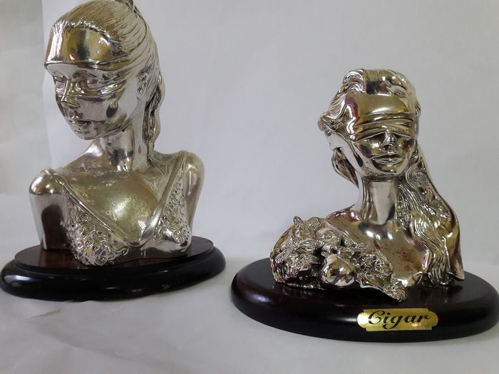 Pair of statues Goddess luck rolled silver. - Silver laminated