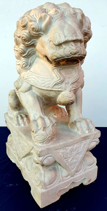 Fine sculpture depicting Leo sitting on the pedestal and sphere