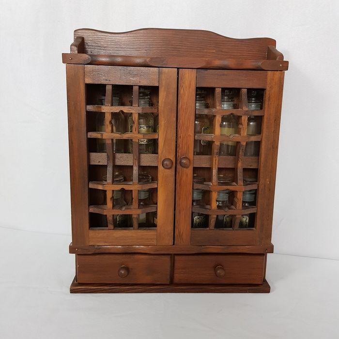 Herb cabinet stuffed with herb jars - wood, glass