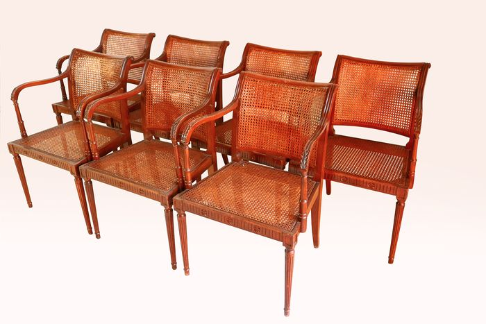 Set of wicker-back dining chairs