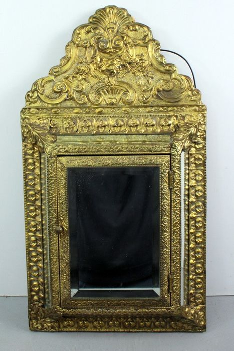 A neck mirror with facet cut glass - glass, wood and latin copper