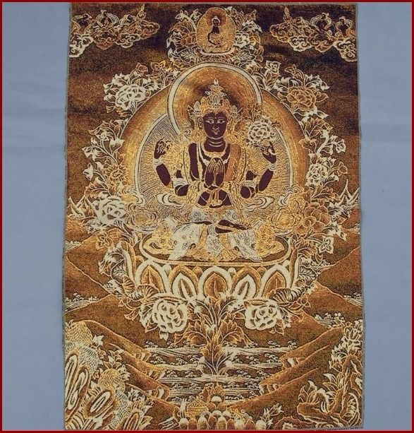 "Thangka - Embroidery (1) - Buddhist figure - Brocade and silk - ""Four-armed yellow Tara Guanyin"" - Tibet - Late 20th century"