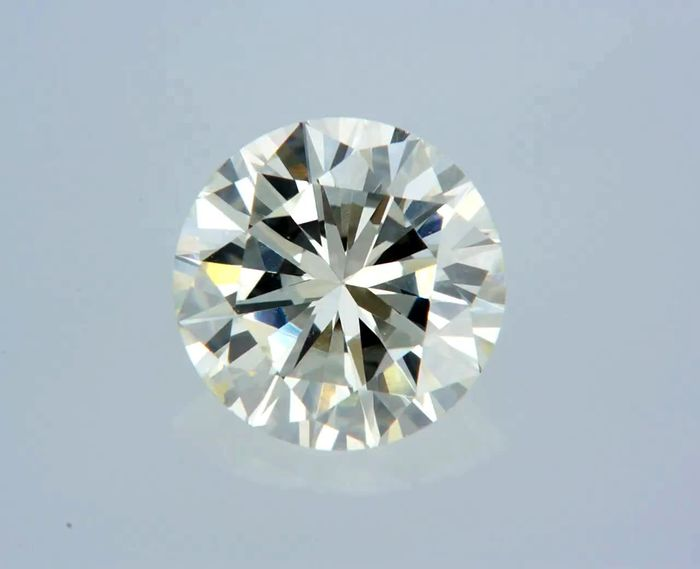 1 pcs Diamante - 0.70 ct - Redondo - L - VS1