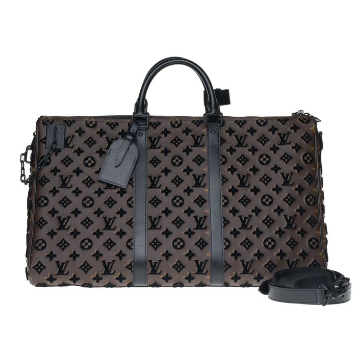 Louis Vuitton - SOLD OUT - Keepall Triangle 50 bandoulière Monogram en tuffetage, état neuf ! Travel bag
