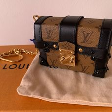 Louis Vuitton - Clutch Essential Trunk Monogram Coated Canvas Wristlet Pochette