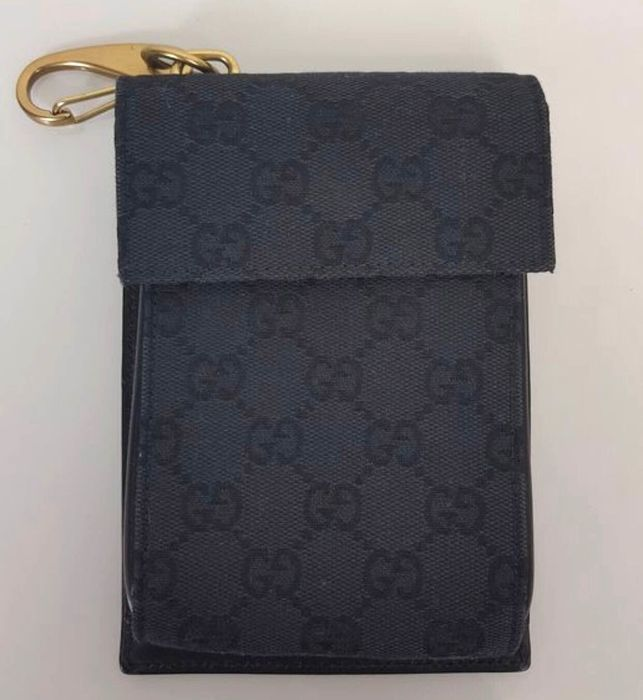 Gucci object / cell phone holder