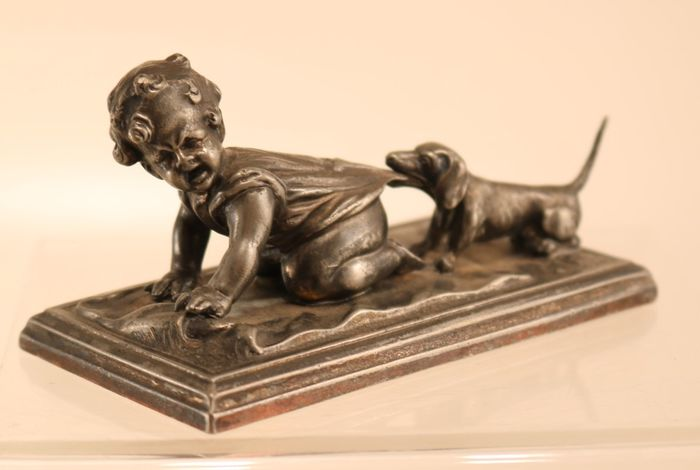 Antique sculpture child with dog - metal alloy - circa 1920