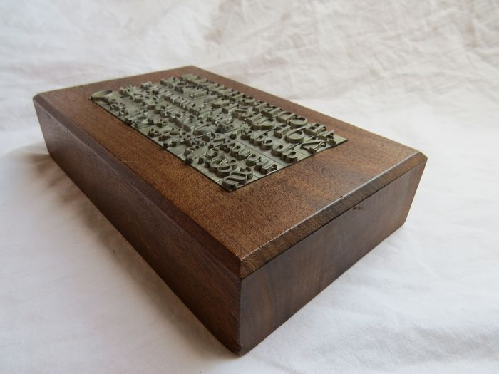 Lead letters (upper and lowercase) letters, numbers and punctuation marks with serif in an art nouveau oak