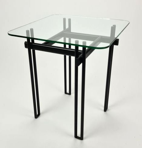 Side table, a metal base and a glass plate as a table top