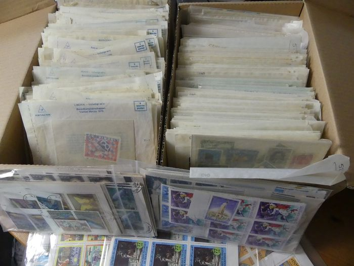 World - Batch of stamps with various topics in bags in two boxes