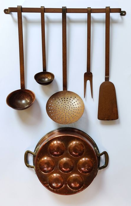 Copper rack with utensils and a poffertjes pan - Copper