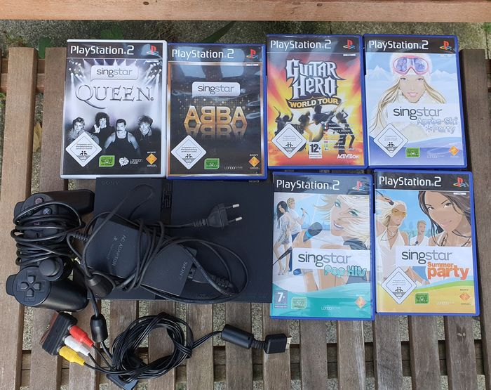 1 Sony PlayStation 2 Slimline SingStar Version - Console with games (6)