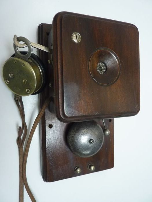 The Antwerp Telephone and Electric Works - A wooden wall phone, ca.1900 - oak case, metal bell and copper earpiece