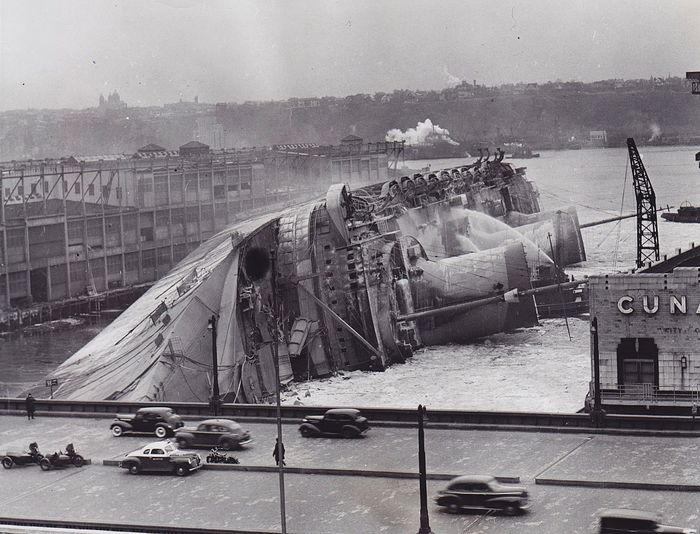 International News Photos - SS Normandie at New York City's Pier 88 on Feb. 9, 1942. Burned, rolled, and sank.