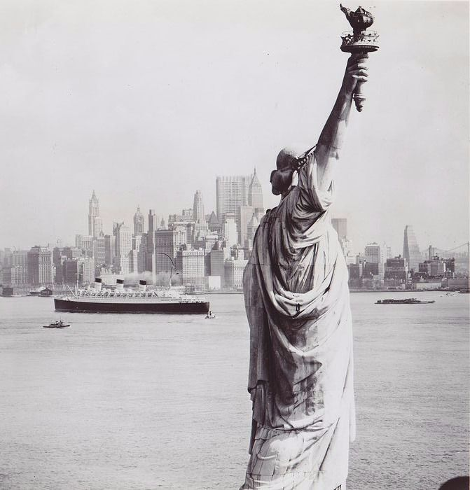 N.Y Visitors Bureau - Ocean liner crosses the Hudson River in front of the Statue of Liberty, 1966