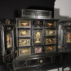 Cabinet with twelve drawers, scagliola panels and bronze handles