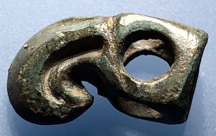 Ancient Scythian Bronze Beautiful and still Wearable Three-Dimensional Openwork Amulet-Pendant shaped as a Griffins Head.