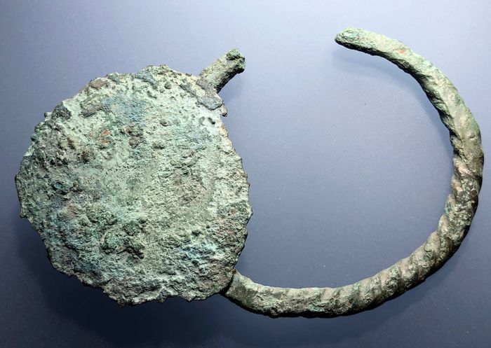 Prehistoric, Iron Age Bronze Exceptional Pseudo-Twisted Bracelet with Unusual Solar Circle Applique forming a Fascinating Style