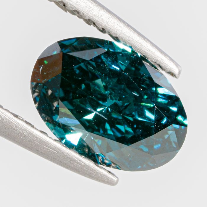 Diamante - 1.07 ct - Ovalado - Fancy Deep Greenish Blue Colour Treated - I1