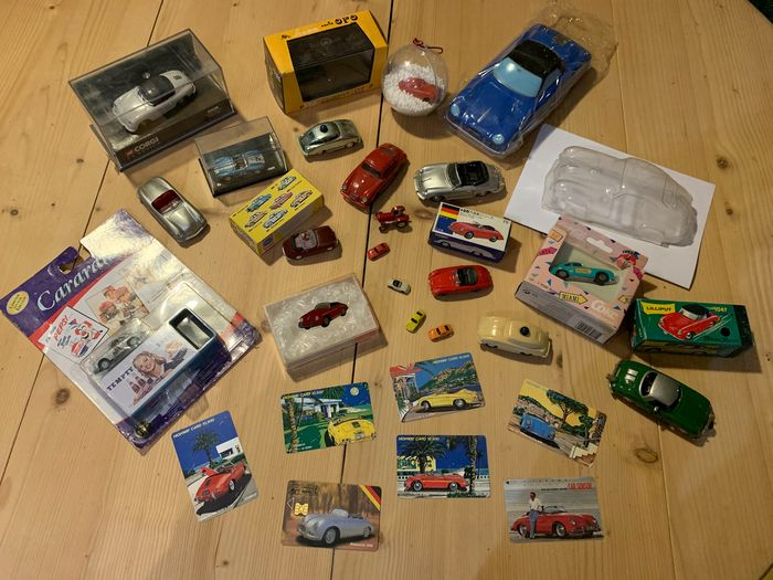 Preview of the first image of Tomica - 1:43 - Porsche 356 - Porsche 550 and tractor.