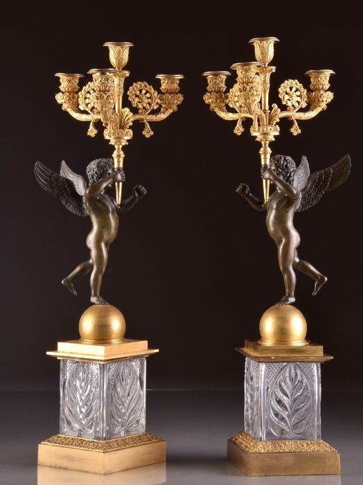 Preview of the first image of A pair of 4-light candelabra with cupids on a crystal base - Louis Philippe - Bronze (gilt), Bronze.