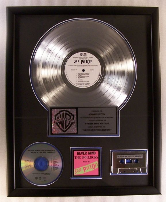 """Sex Pistols - """"Never Mind The Bollocks"""" LP, Cassette, CD Platinum Record Award Presented To Johnny Rotten - Official In-House award - 1992/1992"""