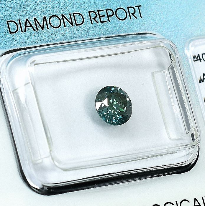 Diamante - 0.77 ct - Brillante - Fancy Vivid Green Blue - I1 - VG/G/VG