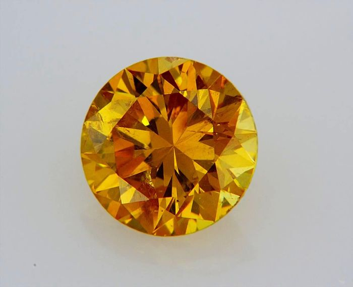 1 pcs Diamante - 0.71 ct - Redondo - fancy vivid orange yellow - GIA CERTIFIED