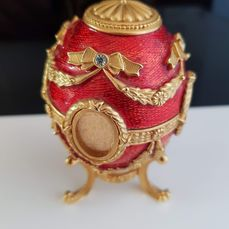 Joan Rivers  - Fabergé inspired  red guilloche enamel egg with 24k gold plated stand