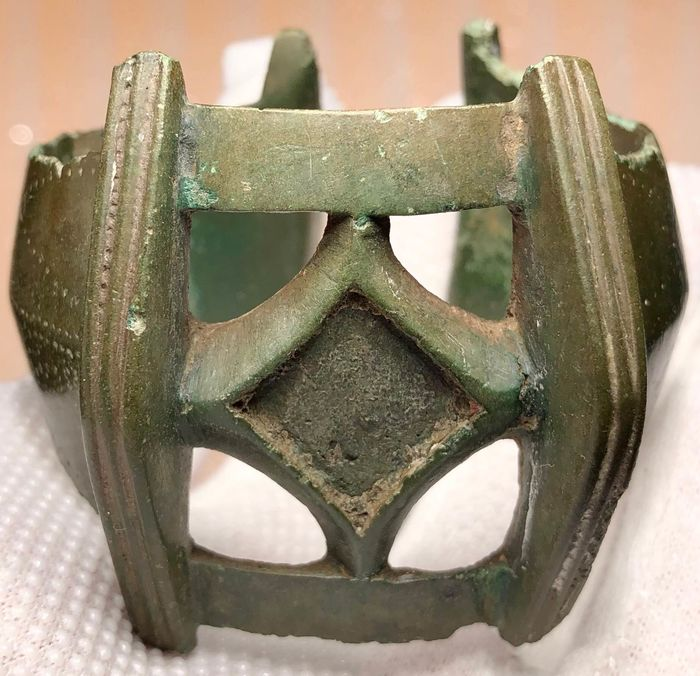 Early medieval Bronze Massive Openwork Bracelet with a Central part shaped as a Rhombic stylization of a Cross.