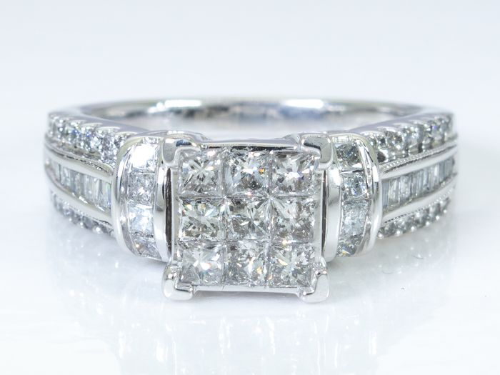 14K Gold - 1.15 Ct - diamond entourage ring with 9 princes cut centers.