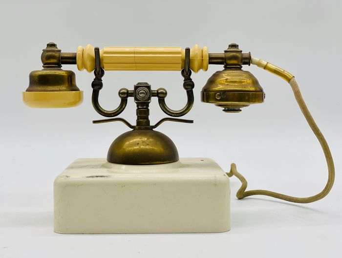 Old Telephone Device - Bronze, early plastic